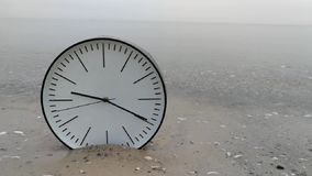 Time Concept Background, White Clock in Sand Water Sea Ocean. Time Concept Background, White Wall Clock with Black Arrows in Sand Water Sea Ocean. Idea for stock video footage