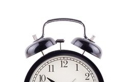 Time concept  Black Color Classic alarm clock isolated over whit. E background Royalty Free Stock Images