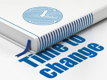 Time concept: book Clock, Time to Change on white background. Time concept: closed book with Blue Clock icon and text Time to Change on floor, white background Stock Photos