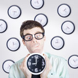 Time concept of a businessman holding quick clock Royalty Free Stock Photo