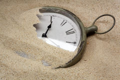 Time concept with a cklock on the sand Royalty Free Stock Photography