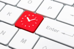 Time concept: Clock on computer keyboard Stock Images