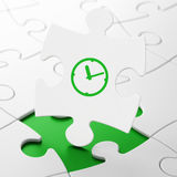 Time concept: Clock on puzzle background Stock Photography