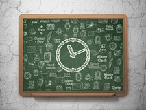 Time concept: Clock on School Board background Royalty Free Stock Photos