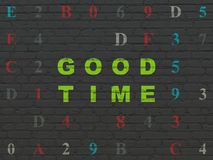 Time concept: Good Time on wall background. Time concept: Painted green text Good Time on Black Brick wall background with Hexadecimal Code Stock Photo