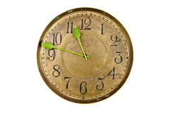 Time concept - green poppy head arrows on old clock face dial Royalty Free Stock Image