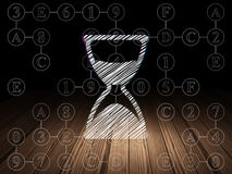Time concept: Hourglass in grunge dark room Stock Image