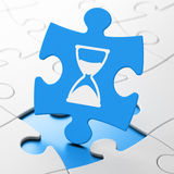 Time concept: Hourglass on puzzle background. Time concept: Hourglass on Blue puzzle pieces background, 3d render Stock Photo