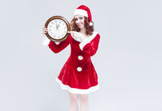 Time Concept and Ideas. Gleeful Red-Haired Santa Helper With Big Royalty Free Stock Photo