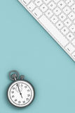 Time Concept. Keyboard with Stopwatch. 3d Rendering. Time Concept. Keyboard with Stopwatch over Turquoise board. 3d Rendering Stock Image