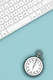 Time Concept. Keyboard with Stopwatch. 3d Rendering. Time Concept. Keyboard with Stopwatch over Turquoise board. 3d Rendering Stock Photos