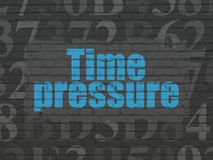 Time concept: Time Pressure on wall background. Time concept: Painted blue text Time Pressure on Black Brick wall background with  Hexadecimal Code Stock Image
