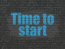 Time concept: Time to Start on wall background Royalty Free Stock Image