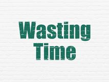 Time concept: Wasting Time on wall background. Time concept: Painted green text Wasting Time on White Brick wall background Royalty Free Stock Images
