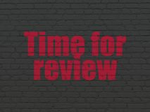 Time concept: Time for Review on wall background Royalty Free Stock Photography