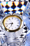 Time concept; past & future. Time abstract showing a crystal, time piece & black & white retro tile pattern reflected in the crystal royalty free stock images