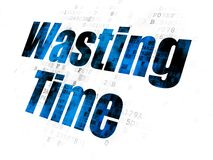 Time concept: Wasting Time on Digital background. Time concept: Pixelated blue text Wasting Time on Digital background Royalty Free Stock Images