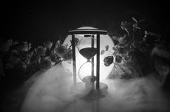 Time concept. Sand passing through the glass bulbs of an hourglass measuring the passing time as it counts down to a deadline. Sil Royalty Free Stock Photo