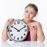 Time concept for smiling beautiful young blod woman Stock Images