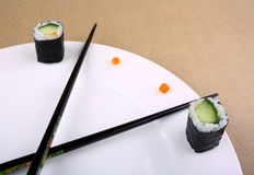 Time Concept of sushi on white plate Royalty Free Stock Photos