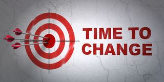 Time concept: target and Time to Change on wall background Stock Photos