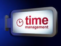 Time concept: Time Management and Clock on billboard background Royalty Free Stock Photos