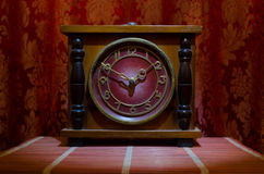 Time concept - vintage wood clock face with grunge texture at dark red maroon curtain background, Royalty Free Stock Photo