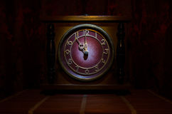 Time concept - vintage wood clock face with grunge texture at dark red maroon curtain background, eleven o clock Royalty Free Stock Photography