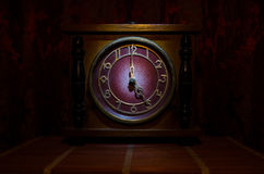 Time concept - vintage wood clock face with grunge texture at dark red maroon curtain background, five o clock Stock Image