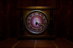 Time concept - vintage wood clock face with grunge texture at dark red maroon curtain background, four o clock Stock Photo