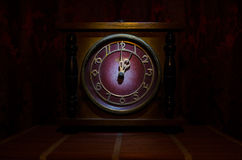 Time concept - vintage wood clock face with grunge texture at dark red maroon curtain background, one o clock Stock Photos
