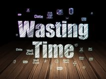 Time concept: Wasting Time in grunge dark room. Time concept: Glowing text Wasting Time,  Hand Drawing Time Icons in grunge dark room with Wooden Floor, black Royalty Free Stock Images