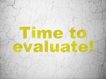 Time concept: Time to Evaluate! on wall background Royalty Free Stock Image