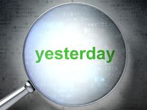 Time concept: Yesterday with optical glass Royalty Free Stock Images