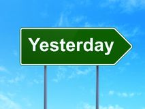 Time concept: Yesterday on road sign background. Time concept: Yesterday on green road highway sign, clear blue sky background, 3D rendering Stock Photography