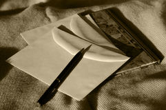 Time for contemplation. Writing utensils: Diary, envelopes, pen stock photography