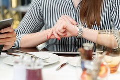 Time control during business lunch Stock Photography