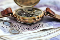 Time costs money Stock Images