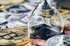 Time countdown for crypto currency price, sandglass or hourglass. With various of shiny silver and golden physical cryptocurrencies symbol coins including royalty free stock images