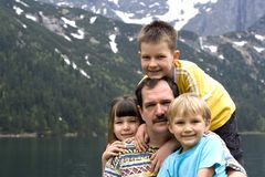 Time with Dad. Kids posing and having  fun with Dad in the mountains on vacation Stock Photography
