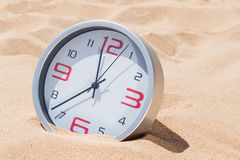 Time deadline. Hours on the beach. Stock Photo