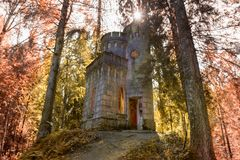 Old chapel. The time-destroyed romantic chapel-tomb 1914. Manor Zavetnoye. Novgorod Region, Russia Royalty Free Stock Images