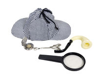 Time for Detective Work. Shown by an antique silver pocket watch, meershaum pipe, magnifying glass and deerhunter cap - path included royalty free stock images