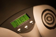 Time for a diet. Bathroom scale showing DIET on its display Royalty Free Stock Photography