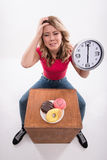 Time for diet slimming. Beautiful woman with clock Stock Images