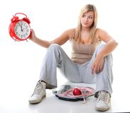 Time for diet slimming. Large girl with scale. Royalty Free Stock Photos