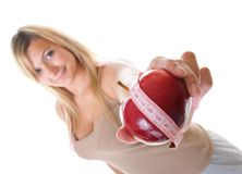 Time for diet slimming. Woman with apple Royalty Free Stock Image