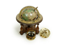 Time and distance. Sundial telling the number of hours to go or the years left, Antique time zone converter used by travellers, Old world globe with basic Stock Photos