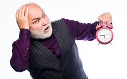 Time does not spare anyone. Time and age concept. Bearded man clock ticking. Aged man holding alarm clock. Senior man. White beard. Senior timekeeper. Counting stock photography
