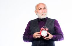 Time does not spare anyone. Time and age concept. Bearded man clock ticking. Aged man holding alarm clock. Senior man. White beard. Senior timekeeper. Counting stock image